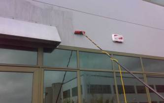 Cladding cleaning with brush